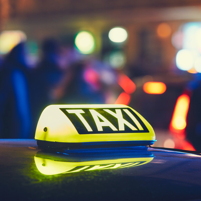 """Taxi car on the street at the night"" stock image"