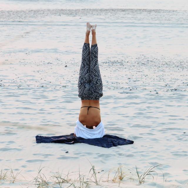 """Yoga on the beach"" stock image"