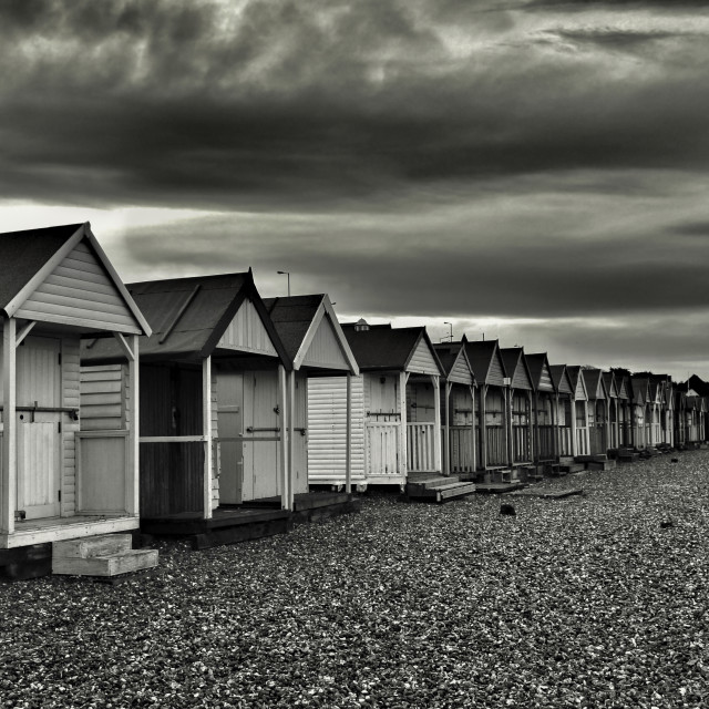 """Black and white beach huts"" stock image"