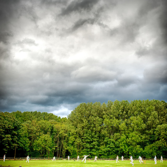 """""""Cricket match before the storm"""" stock image"""