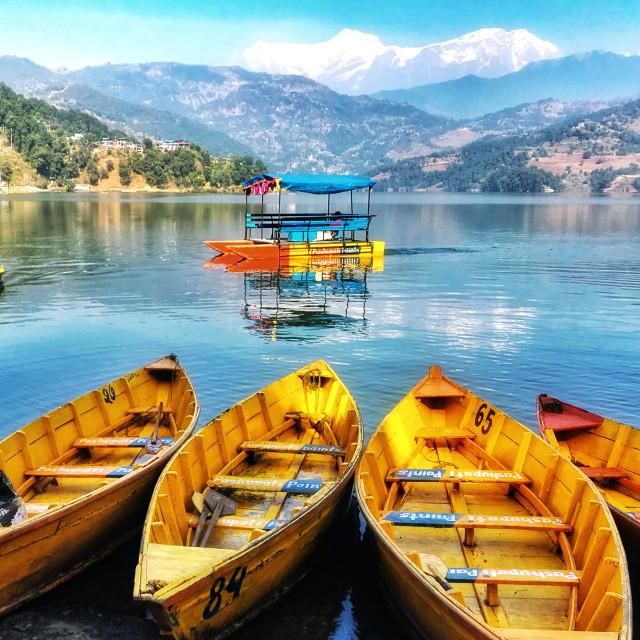 """Boating with reflection of Himalayan Range"" stock image"