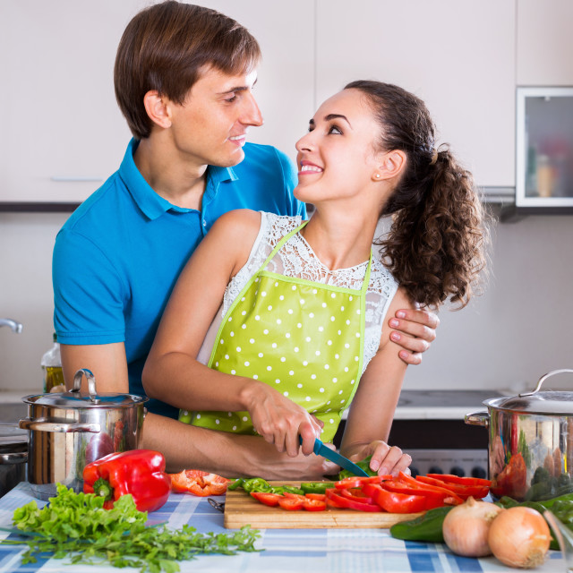 """Vegeterian couple preparing soup with vegetables"" stock image"