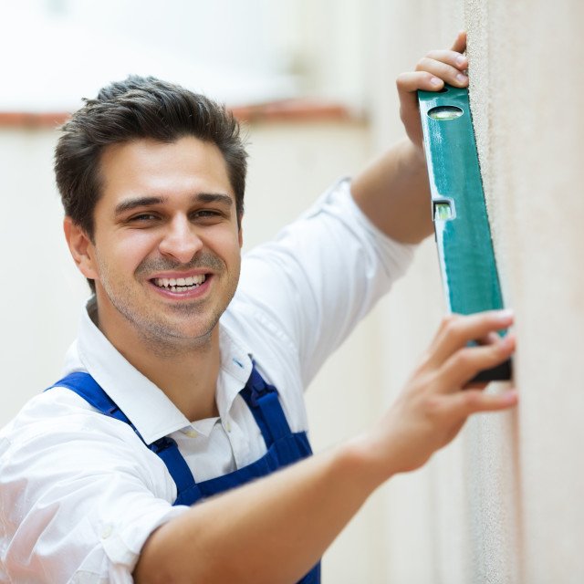 """Specialist making wall plane"" stock image"