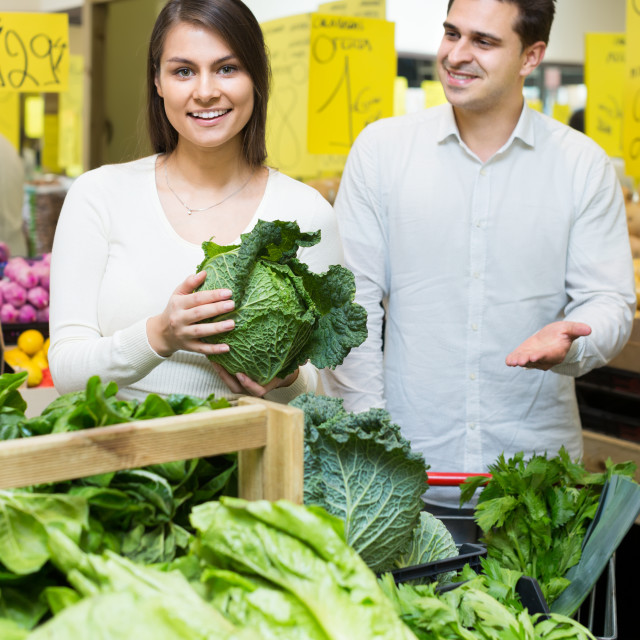 """spouses choosing veggies in store"" stock image"