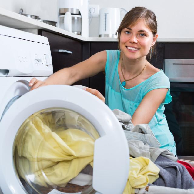 """Housewife near washing machine"" stock image"