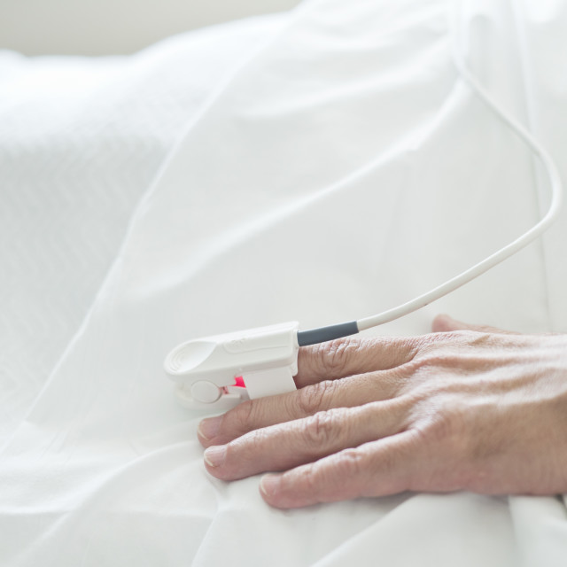 """Patient's hand with pulse oximeter"" stock image"