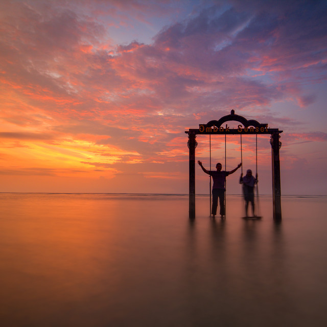 """Swing Under the Red Sky"" stock image"