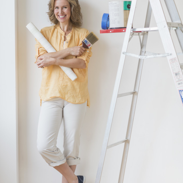 """Portrait of woman doing home improvement"" stock image"