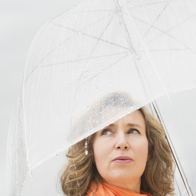 """Woman with umbrella"" stock image"
