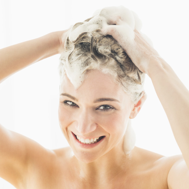 """Beautiful woman washing hair"" stock image"