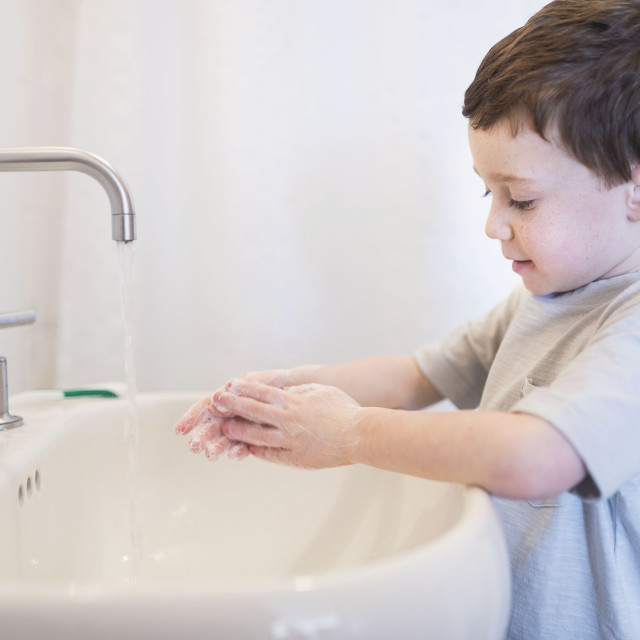 """boy (6-7) washing hands"" stock image"