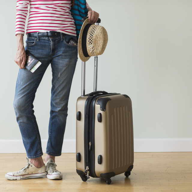 """Woman ready to go on vacations"" stock image"