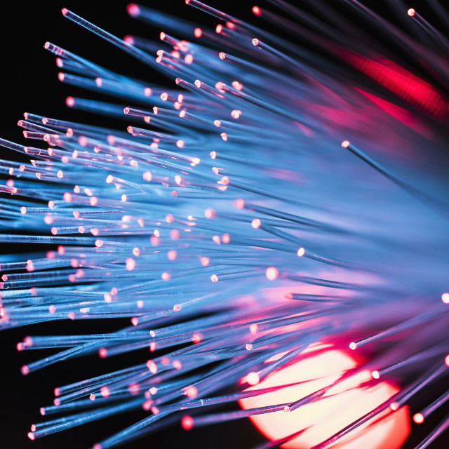 """Bunch of illuminated fiber optic cables"" stock image"