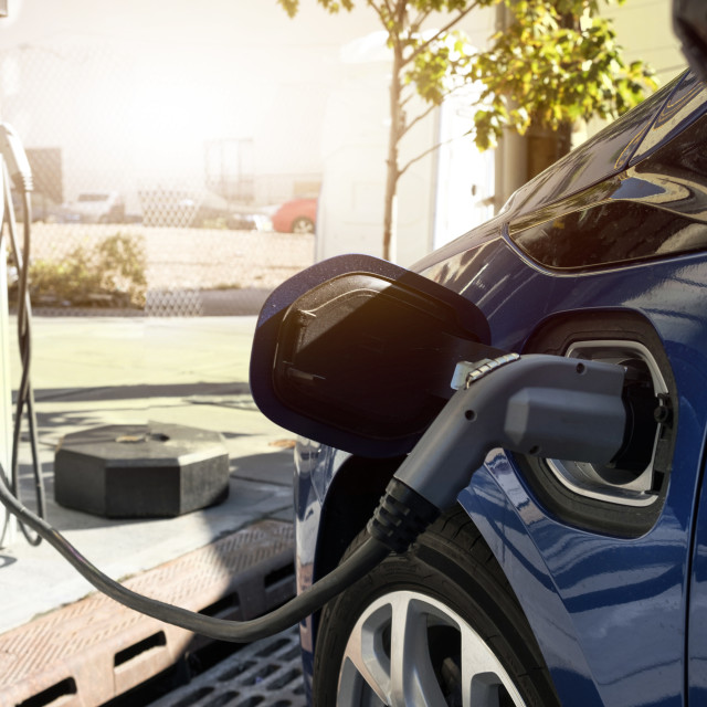 """""""Electric car recharging in charging station"""" stock image"""