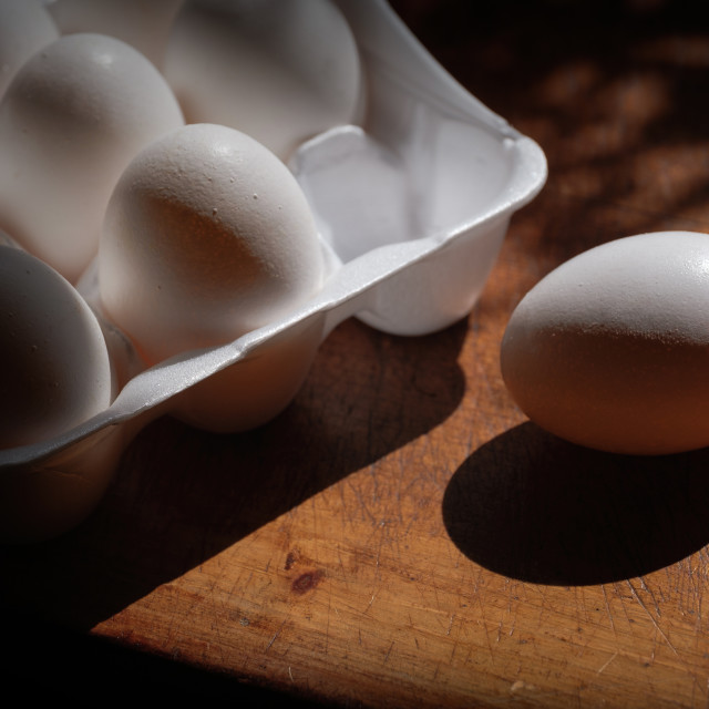 """Fresh eggs in carton on table"" stock image"