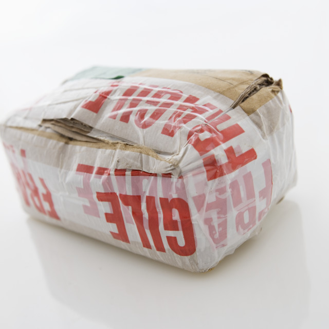 """""""Bulky package with fragile tape"""" stock image"""