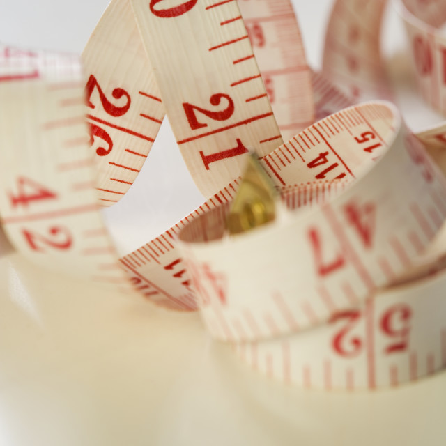 """Still life of tape measure"" stock image"