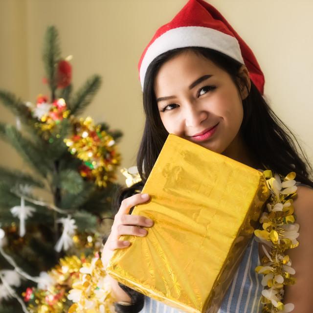 """Happy girl hold golden Xmas gift box"" stock image"