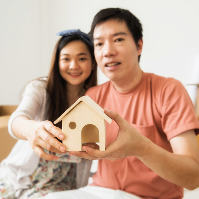 """""""Happy couple hold Mock up home model"""" stock image"""