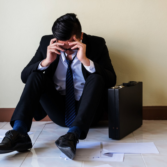 """""""Stressed Asian Businessman get fired."""" stock image"""