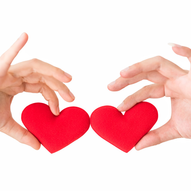 """""""Red heart on couple hands isolated"""" stock image"""