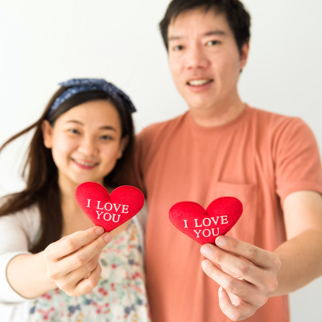 """""""Happy couple hold red heart"""" stock image"""