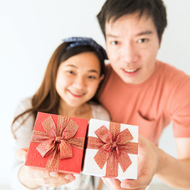 """""""Top view of couple holding valentine gift"""" stock image"""