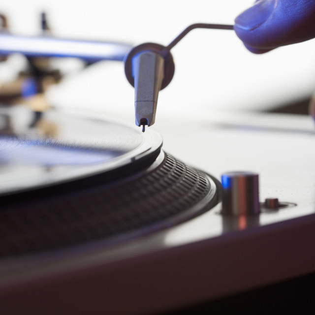 """""""Person setting needle on a record"""" stock image"""