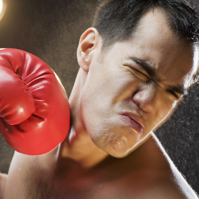 """Boxer taking a punch to the head"" stock image"