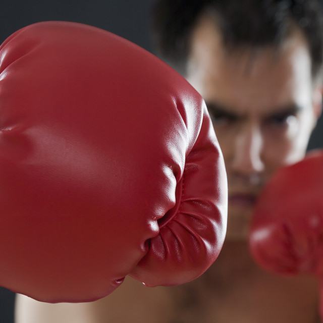 """A boxer throwing punches"" stock image"