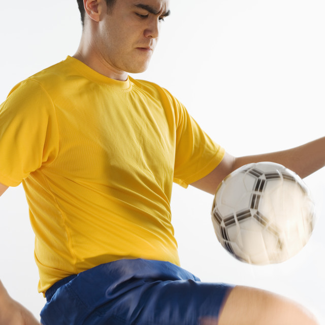 """""""Man playing with soccer ball"""" stock image"""