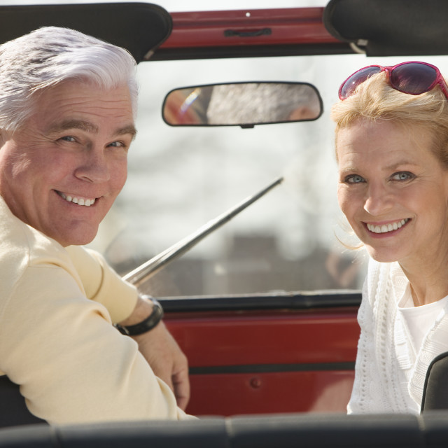 """Senior couple sitting in jeep"" stock image"