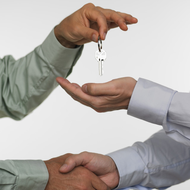 """""""Two men closing deal and handing over keys"""" stock image"""