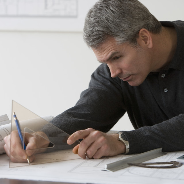 """""""Male architect working at desk"""" stock image"""