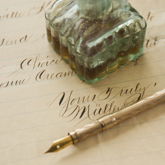 """Quill pen and ink bottle on old letter"" stock image"