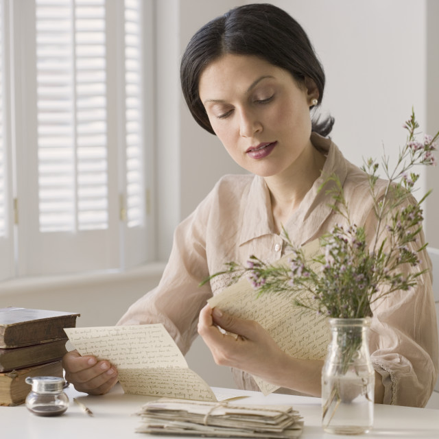 """Woman in vintage clothing reading letter"" stock image"