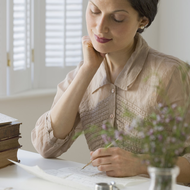 """Woman in vintage clothing writing letter"" stock image"