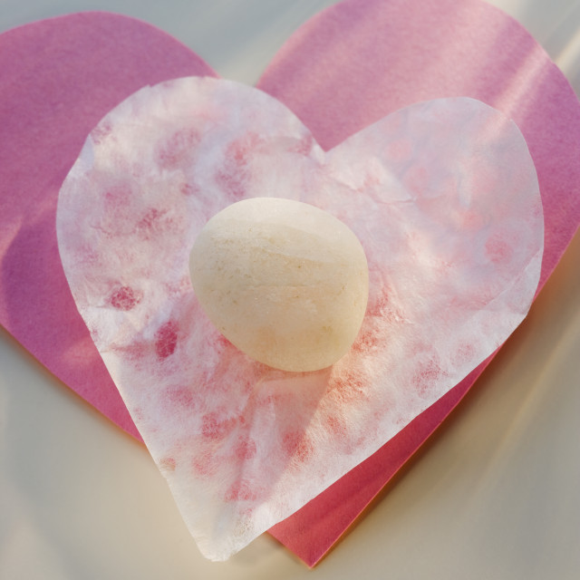 """""""Candy on heart-shaped paper"""" stock image"""