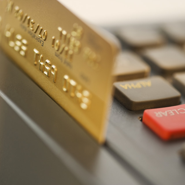 """""""Close up of credit card machine and credit card"""" stock image"""