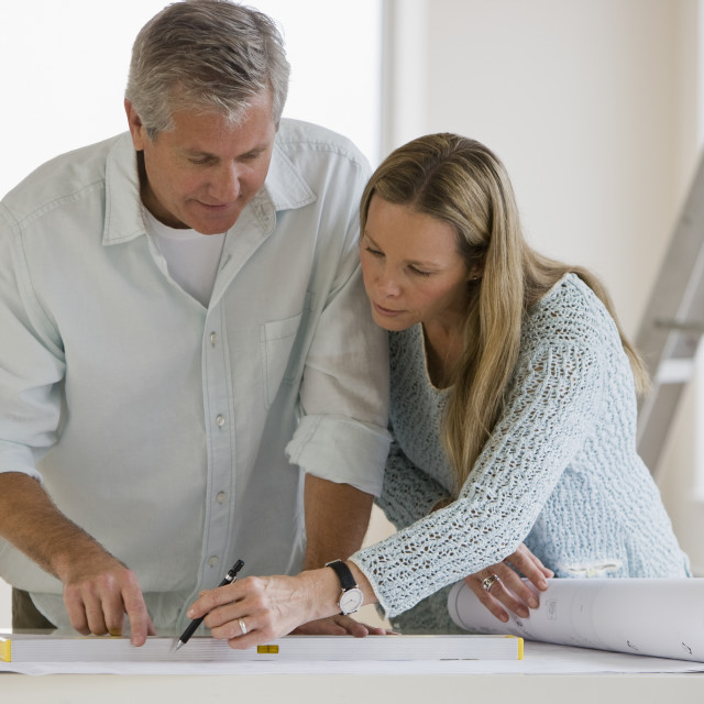 """""""Couple looking at blueprints"""" stock image"""