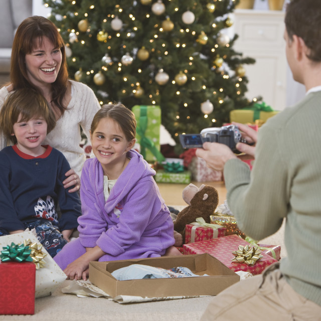 """Father video recording family on Christmas"" stock image"