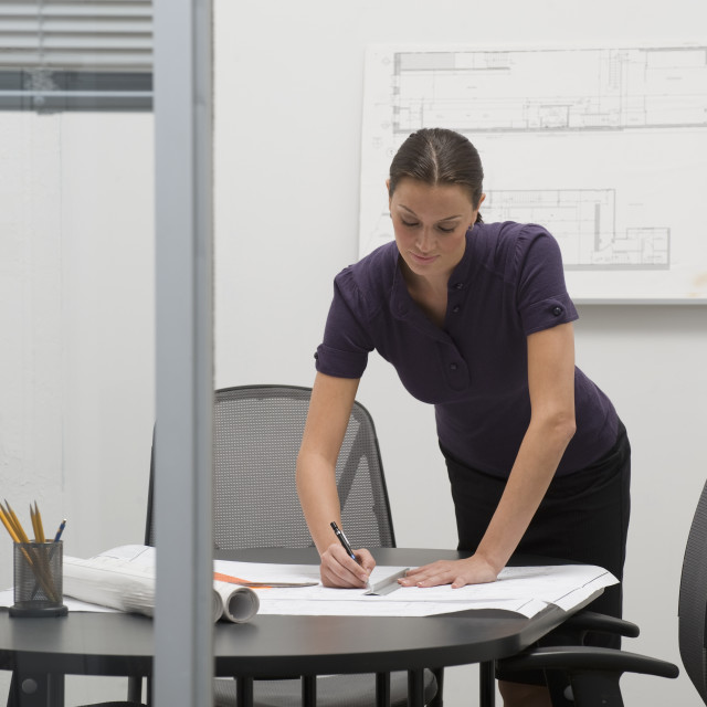 """""""Architect working on blueprints in office"""" stock image"""