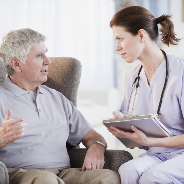 """Nurse talking to senior man"" stock image"