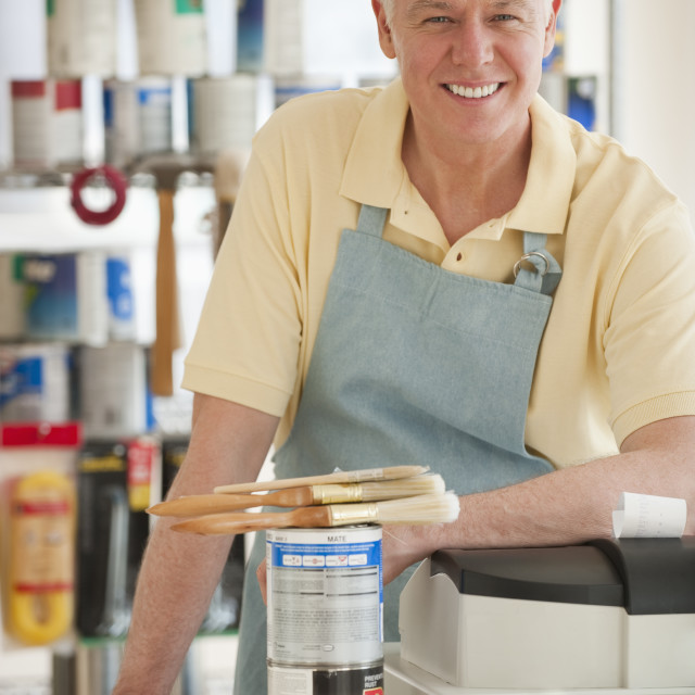 """""""A man working at a paint store"""" stock image"""