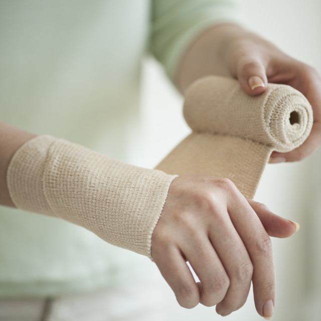 """Wrapping hand in tensor bandage"" stock image"