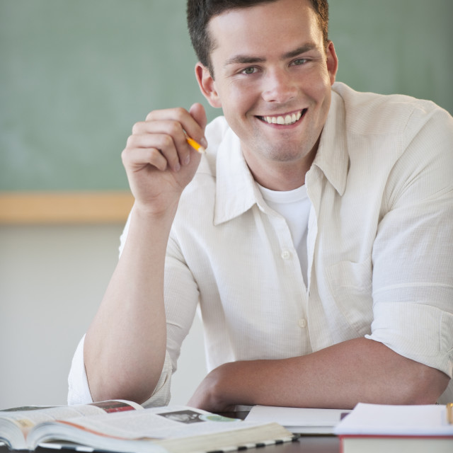 """Male student smiling"" stock image"