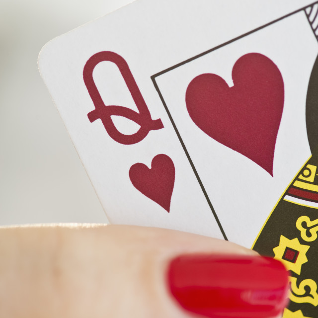 """Hand holding a queen of hearts card"" stock image"