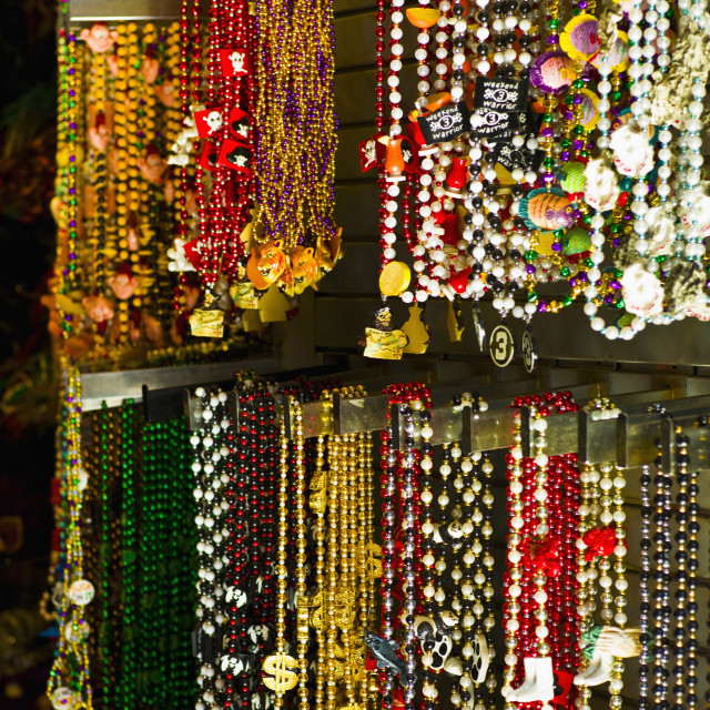 """Mardi grass beads on display in a store in New Orleans"" stock image"