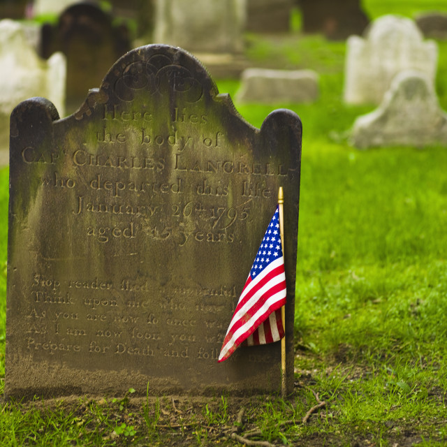 """American flag in front of tombstone"" stock image"
