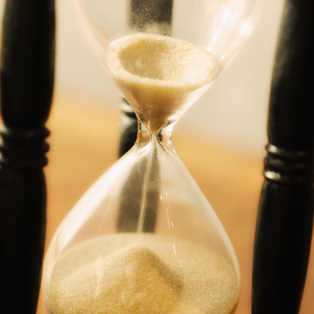 """Hourglass with pouring sand"" stock image"